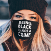 Being black is not a crime face mask
